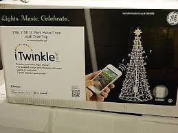 itwinkle christmas tree ge itwinkle 7 5 ft musical outdoor indoor christmas tree 300