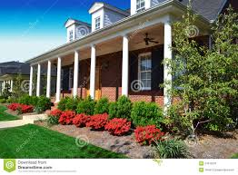 brick cape cod style home in the springtime stock image image