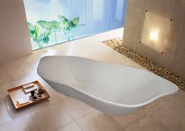 white glossy stone for standing tub attached on grey cement wall