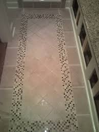 Shower Floor Mosaic Tiles by Tile Floor With Inlaid Design Leading To The Custom Shower