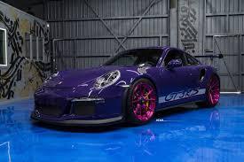 pink porsche 911 ultraviolet porsche 911 gt3 rs poses with pink wheels