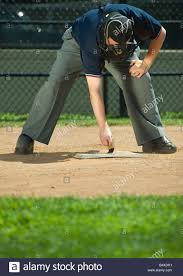 baseball umpire sweeping home plate stock photo royalty free