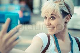 hipster hair for women beautiful young blonde short hair hipster woman selfie in the city