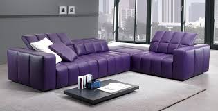purple sofa with cushions on grey ceramic flooring tile soft