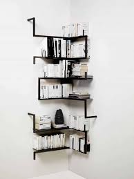 contemporary corner shelves mounted in the white walls for books