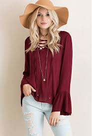 burgundy blouse lace up bell sleeve top in burgundy at shoptristin com tristin