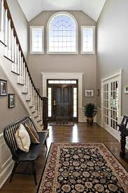 Wood Area Rugs Large Two Story Foyer French Doors White And Wood Staircase