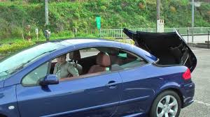 automatic retractable hardtop of peugeot 307cc open the roof