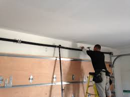 Installing An Overhead Garage Door Door Garage Garage Door Repair Garage Door Installation