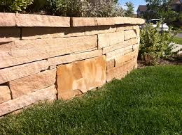 buff strip stone retaining wall front yard redesigns pinterest