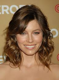 shoulder length hair for women with pear shaped faces hairstyle with bangs and volume for women with pear shaped face