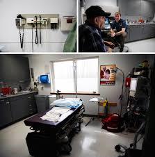 in rural alaska a young doctor walks to his patient u0027s bedside
