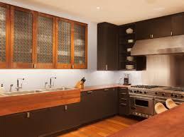 kitchen electric range under cabinet range hood wood wall