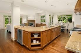 what color kitchen cabinets go with hardwood floors what wood color would go well on the rest of my living area