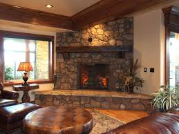 immaculate stacked stone fireplace with wooden mantel as well as