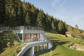 homes built into hillside swooping home is partially built into a hillside curbed