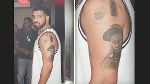 drake has lil wayne u0027s face tattooed on his arm youtube
