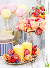 birthday party table setting food and floral decorations stock