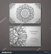 silver business card with flower and ornaments in baroque style