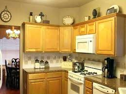 top of kitchen cabinet decor ideas top of kitchen cabinet decor musicyou co