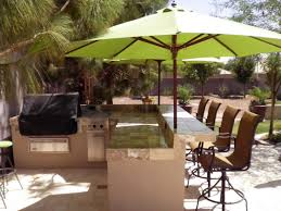 exterior interesting backyard patio ideas with green umbrella and