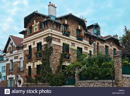 beautiful house in the victorian style of beige brick with flowers