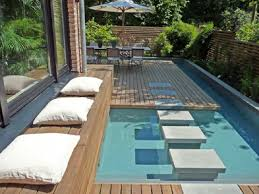 Backyard Swimming Pool Designs by Amusing Backyard Swimming Pool With Unique Decor Unique Swimming