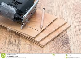 Free Laminate Flooring Wood Laminate Flooring And Electric Jigsaw Royalty Free Stock