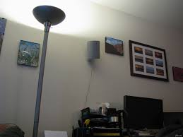home theater wiring how to hide wall mounted speaker wires in your apartment for under