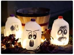Halloween Decorations Using Milk Jugs - turn plastic jugs into halloween ghosts the artful crafter