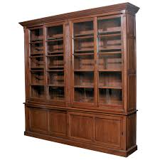 bookcase with bottom doors high brown wooden bookshelf with sliding glass door for shelves