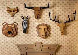 wall masks masquerade s wooden wall masks lend mischievous charm to