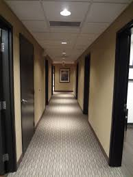 hallway of medical office with carpet custom stained oak doors