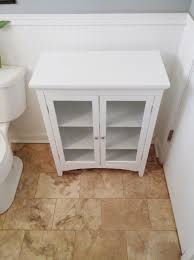 bathroom linen cabinets for inspiration to remodel the main bathroom bathroom linen cabinets which includes a basket of rolls and a wire rack on