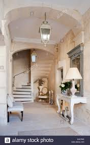 Entrance Hall Table by Hall With Staircase And Console Table In Converted Victorian Stock