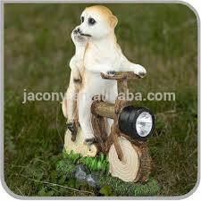 meerkats on bike with solar powered light garden ornaments jl r