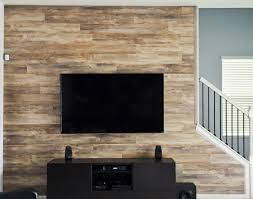 Wood Wall Living Room by Laminate Flooring On Walls For A Warm And Luxurious Feel Of The