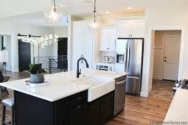 kitchen with black island and white cabinets iowa cities black and white kitchen home