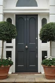 black panelled door topiary trees front door design ideas