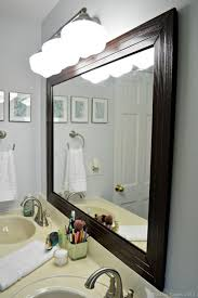 How To Make A Bathroom Mirror Frame Stylish Diy Framed Bathroom Mirror Shelterness