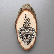 wood slice with original drawing of a sacred all seeing