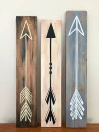 hand painted arrows on old scrap wood random woodworking