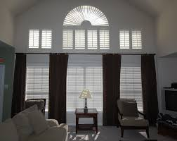 dark ton curtain on wide window combined with white venetian blind