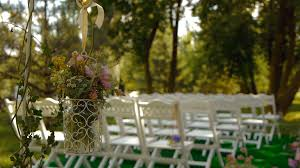 white wooden chairs wedding aisle decor outdoors wedding