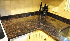 Baltic Brown Granite Countertops With Light Tan Backsplash by Tan Brown Granite Countertops Natural Stone City Natural Stone