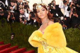 rihanna wore a gold cape gown to met gala 2015 and she looked like