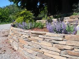 Garden Rock Wall by Deeproots Landscape U0026 Nursery Custom Residential And Commercial