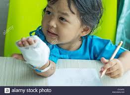 kids writing paper illness little asian kids writing paper on desk in hospital illness little asian kids writing paper on desk in hospital saline intravenous iv on hand