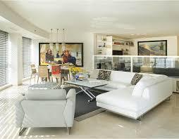 living rooms pendant light beige wall black rug built in shelves