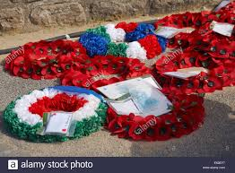 memorial wreaths laid in remembrance outside musee du debarquement d